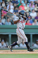 Shortstop Ozhaino Albies (7) of the Rome Braves bats in a game against the Greenville Drive on Friday, June 12, 2015, at Fluor Field at the West End in Greenville, South Carolina. Greenville won, 10-8. (Tom Priddy/Four Seam Images)
