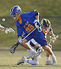 Danny Penny #38 of West Islip, front, looks to gain possession after taking a faceoff in a Suffolk County varsity boys lacrosse game against Northport at Veterans Park in East Northport on Monday, Apr. 18, 2016. West Islip won by a score of 10-9.
