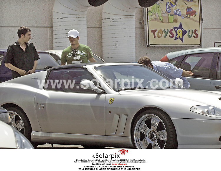 ALL ROUND EXCLUSIVE PICTURES BY SOLARPIX.COM. .24.08.06.David Beckham shopping at Toys R Us in Madrid  for birthday presents for Romeo, his second oldest son, who will be four on 01.09.06. Beckham surprised two young car enthusiasts who had been checking out his silver Ferrari, when he returned to the car . JOB REF:2743-ROL..MUST CREDIT SOLARPIX.COM OR DOUBLE FEE WILL BE CHARGED.....