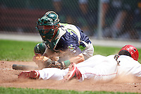 Vermont Lake Monsters catcher Brett Sunde (24) looks to tag Dalton Dulin (1) sliding home safely during a game against the Auburn Doubledays on July 13, 2016 at Falcon Park in Auburn, New York.  Auburn defeated Vermont 8-4.  (Mike Janes/Four Seam Images)