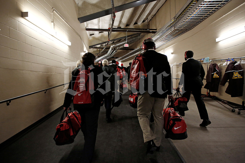 Ohio State Buckeyes linebacker Raekwon McMillan (5) and Ohio State Buckeyes cornerback Nik Sarac (18) are the last players in as the Ohio State Buckeyes head to the locker room before the college football game between the Ohio State Buckeyes and the Minnesota Golden Gophers at TCF Bank Stadium in Minneapolis, Saturday morning, November 15, 2014. (The Columbus Dispatch / Eamon Queeney)
