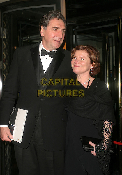 IMELDA STAUNTON & GUEST.The Orange British Academy Film Awards aftershow & Grosvenor House Hotel, London, UK..February 19th, 2006.Ref: AH.half length black dress tuxedo.www.capitalpictures.com.sales@capitalpictures.com.© Capital Pictures.