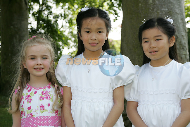 Lynn and Anna Victory with their sister Laura at First Communion in Sandpit on Saturday