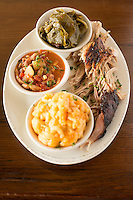 DURHAM, N.C. Tuesday August 5, 2014 - Pulled pork, macaroni, brunswick stew and collards at The Pit Authentic Barbecue in Durham, N.C. (Justin Cook for The New York Times)