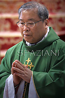 South Korean cardinal Andrew Yeom Soo Jung ,Pope Francis  during  the mass New Cardinals in  St. Peter's Basilica at the Vatican on February 23, 2014