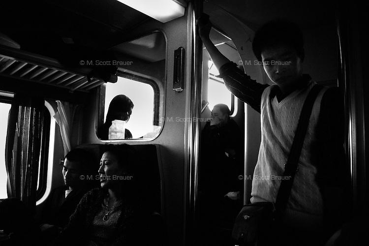 Travelers leave Shanghai, China, by train.