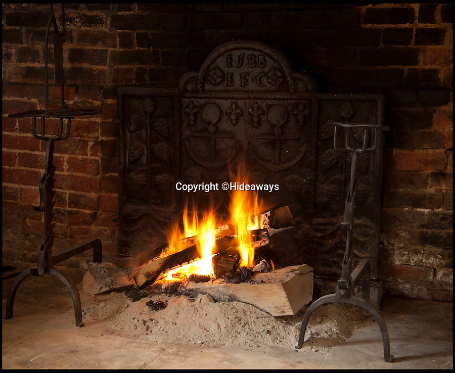 BNPS.co.uk (01202 558833)<br /> Pic: Hideaways/BNPS<br /> <br /> Ancient fireplace with with 1588 grate.<br /> <br /> You can now live like a king... but it will cost you £6,000 a week!<br /> <br /> This stunning historic house offers the ultimate 'Lord of the Manor' experience - but you'll need deep pockets to enjoy the life of luxury.<br /> <br /> The Grade II* listed King John's House has eight opulent bedrooms and exquisite period features dating back to medieval times, but staying there will set you back a whopping £5,682 per week.<br /> <br /> The site in Tollard Royal, Wiltshire, was once a Royal hunting lodge used by King John in the early 13th century but since the death of the last owner William Gronow Davis last year it has now become a very exclusive rental property for groups wanting to celebrate a milestone birthday or anniversary in style.