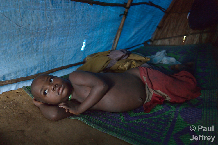 Janti John, 4, wakes up in his family's shelter in a camp for more than 5,000 displaced people in Riimenze, in South Sudan's Gbudwe State, what was formerly Western Equatoria. Families here were displaced at the beginning of 2017, as fighting between government soldiers and rebels escalated.<br />