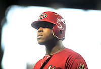 Apr. 25, 2012; Phoenix, AZ, USA; Arizona Diamondbacks outfielder Justin Upton walks back to the dugout after grounding out in the ninth inning against the Philadelphia Phillies at Chase Field. Mandatory Credit: Mark J. Rebilas-