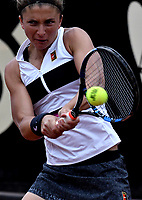 BOGOTÁ-COLOMBIA, 12-04-2019: Sara Errani de Italia, devuelve la bola a Astra Sharma de Australia, durante partido por el Claro Colsanitas WTA, que se realiza en el Carmel Club en la ciudad de Bogotá. / Sara Errani of Italy, returns the ball against Astra Sharma of Australia, during a match for the WTA Claro Colsanitas, which takes place at Carmel Club in Bogota city. / Photo: VizzorImage / Luis Ramírez / Staff.<br />  / Photo: VizzorImage / Luis Ramírez / Staff.
