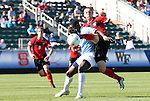 14 November 2010: Maryland's Casey Townsend (right) is defended by North Carolina's Jalil Anibaba (in blue). The University of Maryland Terrapins defeated the University of North Carolina Tar Heels 1-0 at WakeMed Soccer Park in Cary, North Carolina in the ACC Men's Soccer Tournament Championship game.