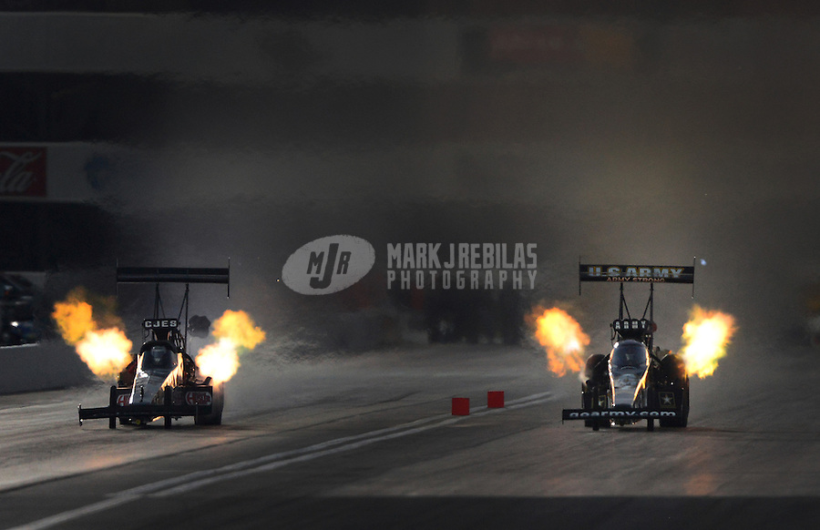 Nov. 10, 2012; Pomona, CA, USA: NHRA top fuel dragster driver Bob Vandergriff (far lane) races alongside Tony Schumacher during qualifying for the Auto Club Finals at at Auto Club Raceway at Pomona. Mandatory Credit: Mark J. Rebilas-