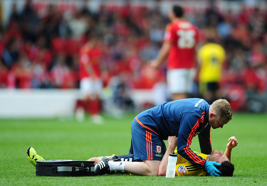 Middlesbrough&rsquo;s David Nugent receives treatment for an injury<br /> <br /> Photographer Chris Vaughan/CameraSport<br /> <br /> Football - The Football League Sky Bet Championship - Nottingham Forest v Middlesbrough - Saturday 19th September 2015 - City Ground - Nottingham<br /> <br /> &copy; CameraSport - 43 Linden Ave. Countesthorpe. Leicester. England. LE8 5PG - Tel: +44 (0) 116 277 4147 - admin@camerasport.com - www.camerasport.com