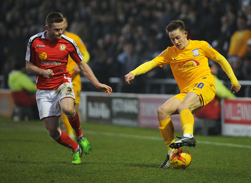 Preston North End's Josh Brownhill under pressure from Crewe Alexandra's Oliver Turton<br /> <br /> Photographer Kevin Barnes/CameraSport<br /> <br /> Football - The Football League Sky Bet League One - Crewe Alexandra v Preston North End - Sunday 28th December 2014 - Alexandra Stadium - Crewe<br /> <br /> &copy; CameraSport - 43 Linden Ave. Countesthorpe. Leicester. England. LE8 5PG - Tel: +44 (0) 116 277 4147 - admin@camerasport.com - www.camerasport.com