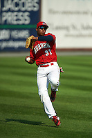 Auburn Doubledays first baseman Diomedes Eusebio (31) throws the ball in during a game against the Batavia Muckdogs on September 7, 2015 at Falcon Park in Auburn, New York.  Auburn defeated Batavia 11-10 in ten innings.  (Mike Janes/Four Seam Images)
