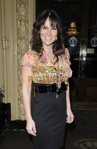 LINDA LUSARDI .Tesco Magazine Mum Of The Year .Awards 2010, held at The Waldorf Hilton Hotel, Aldwych, London, England, UK,.February 28th 2010..Arrivals half length black waist belt high waisted top blouse print pattern pink necklace smiling paisley .CAP/CAN.©Can Nguyen/Capital Pictures