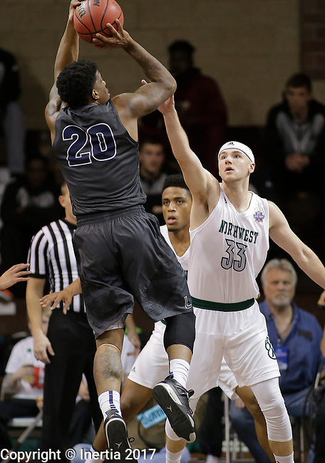 SIOUX FALLS, SD: MARCH 23: Luquon Choice #20 of Lincoln Memorial shoots over Zach Schneider #33 of Northwest Missouri State during the Men's Division II Basketball Championship Tournament on March 23, 2017 at the Sanford Pentagon in Sioux Falls, SD. (Photo by Dick Carlson/Inertia)