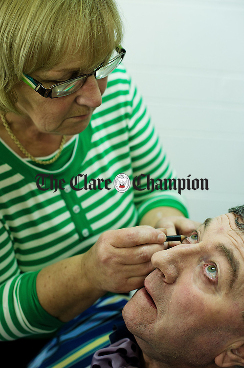 Pat O Reilly gets his make up done by Rona Lyons backstage before taking part in the Corofin Dramatic Society's production of What's For Pudding? at the Doonbeg Drama festival One Act Competition. Photograph by John Kelly.