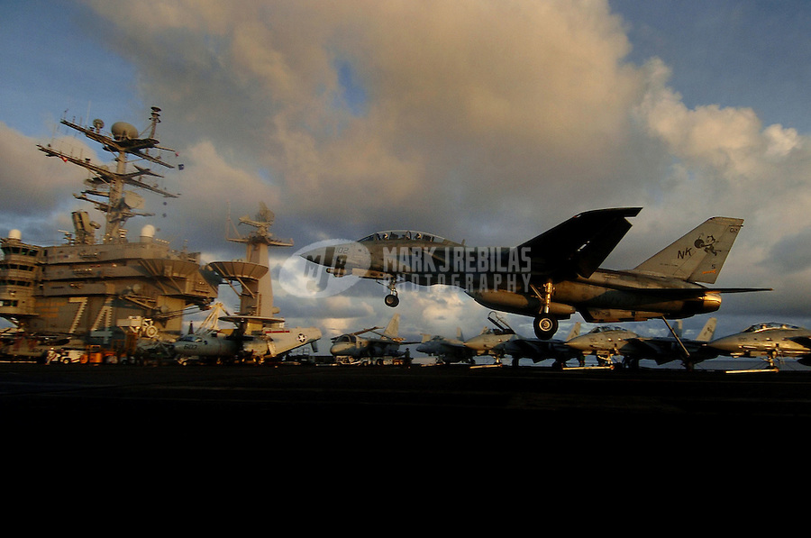 """041019-N-6213R-035 Pacific Ocean (Oct. 19, 2004) - An F-14D Tomcat from the """"Tomcatters"""" of Fighter Squadron Three One (VF-31) lands on the flight deck aboard USS John C. Stennis (CVN 74). Stennis and embarked Carrier Air Wing Fourteen (CVW-14) are at sea on a scheduled deployment to the Western Pacific Ocean. Photo by Mark J. Rebilas"""