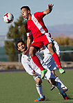 Wooster Colts Nicolas Martinez goes high for the header over Spanish Springs Cristian Gonzalez during the 2013 NIAA Division I Northern Region Boys Soccer Championship played on Saturday afternoon, November 9, 2013 at Bishop Manogue High School in Reno, Nevada.
