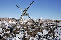 Sunday March 11, 2007   ----   Paul Gehhart runs past a tripod marker on the tundra nearing Unalakleet on Sunday afternoon.
