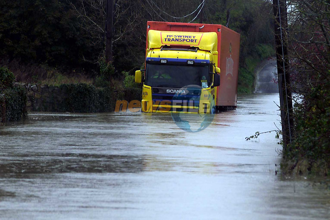 A lorry driver sits stranded in over 4 ft of water on the Julianstown to Duleek road flooded by the River Nanny on Monday Afternoon.Pic Fran Caffrey Newsfile