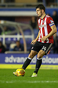 1st November 2017, St. Andrews Stadium, Birmingham, England; EFL Championship football, Birmingham City versus Brentford; John Egan of Brentford plays the ball back to his keeper to clear