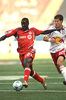 Toronto FC forward Johann Smith (28) is chased by New York Red Bulls defender Luke Sassano (32). The New York Red Bulls defeated Toronto FC 2-0 during a Major League Soccer match at Giants Stadium in East Rutherford, NJ, on August 17, 2008.