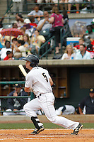 Charleston RiverDogs outfielder Dustin Fowler (5) at bat during a game against the Augusta GreenJackets at Joseph P.Riley Jr. Ballpark on April 15, 2015 in Charleston, South Carolina. Charleston defeated Augusta 8-0. (Robert Gurganus/Four Seam Images)