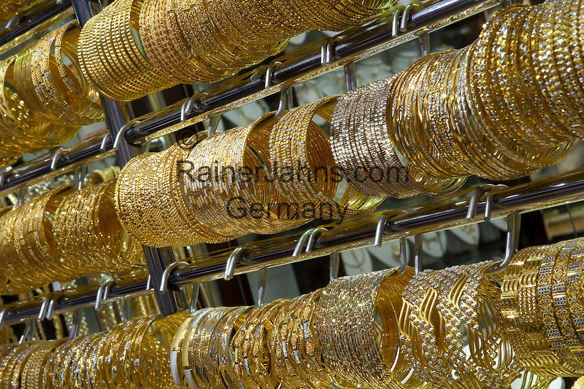 United Arab Emirates, Dubai: Jewellery shop, close up of gold bracelets in the Gold Souk