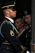 Cindy and Jimmy McCain, right, the wife and son of the late United States Senator John McCain (Republican of Arizona) look on as a Military Honor Guard carries the Senator's casket out of the Cathedral following a funeral for the late Senator at the Washington National Cathedral in Washington, DC on September 1, 2018. <br /> Credit: Alex Edelman / CNP