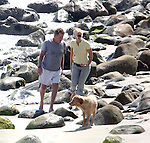 8-7-09...Ryan O'Neal  Oneal walking on the beach in Malibu California with a  blond woman & his dog.  The couple sat down on some rocks & picked up sea shells. ...AbilityFilms@yahoo.com.805-427-3519.www.AbilityFilms.com.