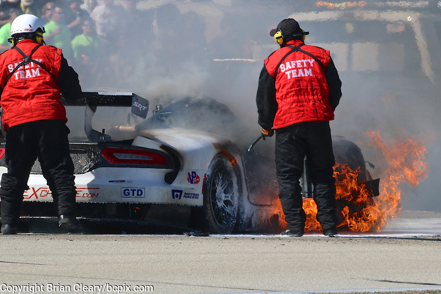 The #33 Viper of Ben Keating, Jeroen Bleekemolen and Sebastian Bleekemolen catches fire early in the 12 Hours of Sebring, Sebring International Raceway, Sebring, FL, March 2014.  (Photo by Brian Cleary/www.bcpix.com)