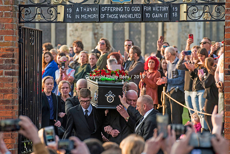 The coffin of the late Prodigy singer Keith Flint is carried out of St Marys Church in Bocking,  Essex today after his funeral service. Kieth's mum Yvonne Flint and sister can be seen directly behind the coffin.