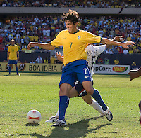 Kaka beats Benny Feilhaber to the ball during a USA vs Brazil international friendly which Brazil won, 4-2, at Soldier Field, Chicago, IL on September 9, 2007.