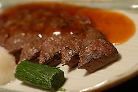 Whale steak at the Kujiraya (Whale) Restaurant in Shibuya, Tokyo Japan. The Restaurant is one of a few that serve exclusively whale meat in Tokyo..20 Nov 2007