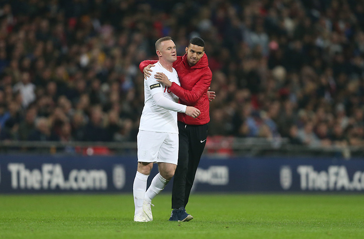 England's Wayne Rooney is hugged by a pitch invader<br /> <br /> Photographer Rob Newell/CameraSport<br /> <br /> The Wayne Rooney Foundation International - England v United States - Thursday 15th November 2018 - Wembley Stadium - London<br /> <br /> World Copyright © 2018 CameraSport. All rights reserved. 43 Linden Ave. Countesthorpe. Leicester. England. LE8 5PG - Tel: +44 (0) 116 277 4147 - admin@camerasport.com - www.camerasport.com