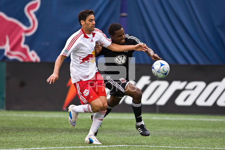 D. C. United forward  Luciano Emilio (11) is marked by New York Red Bulls defender Gabriel Cichero (17). The New York Red Bulls defeated D. C. United 4-1 during a Major League Soccer match at Giants Stadium in East Rutherford, NJ, on August 10, 2008.