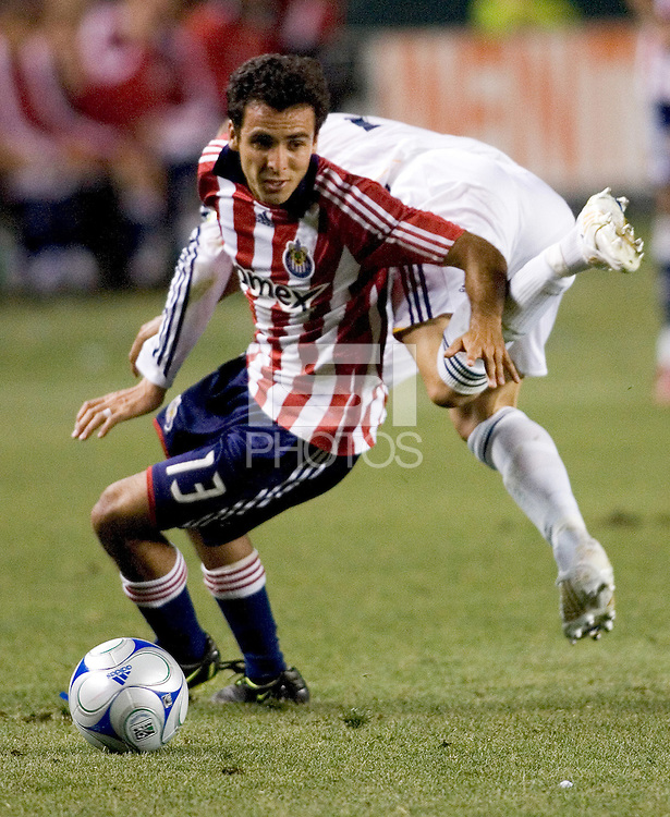 Chivas USA defender Jonathan Bornstein (13) steals the ball from LA Galaxy midfielder David Beckham (23) during the Super Clasico MLS match. The LA Galaxy defeated Chivas USA 5-2 during the SuperClasico at the Home Depot Center Stadium, in Carson, California, Saturday, April 26, 2008.