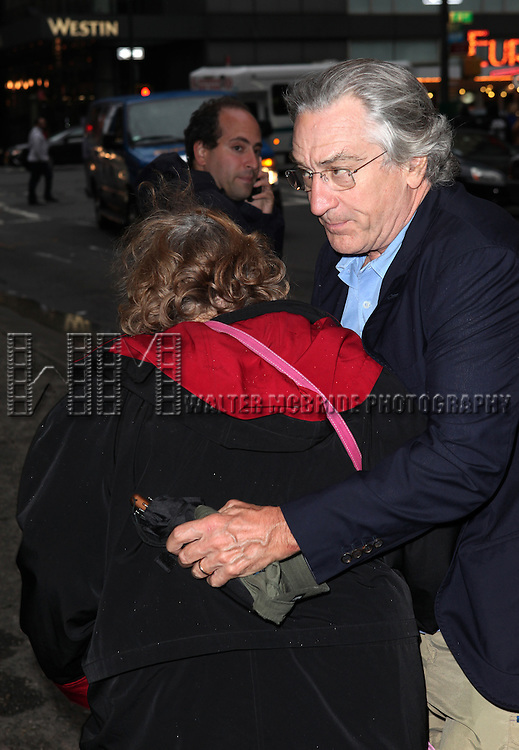 Robert DeNiro avoiding photographers & collides into a woman as he rushes into the Off-Broadway Opening Night Performance of  the Second Stage Theatre's 'Lonely, I'm Not' in New York City on 5/7/2012.