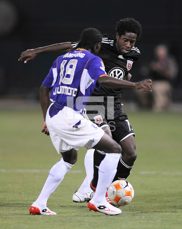 DC United midfielder Clyde Simms (19) controls the ball against Deportivo Saprissa defender Jervis Drummond (18) ,Deportivo Saprissa defeated DC United 2-0,  in the first leg of group A of the Concacaf Champions League ,Tuesday  September 16 , 2008 at RFK Stadium.