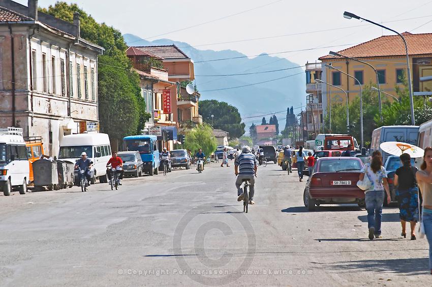 Street scene with cars bicycles, mopeds, pedestrians Shkodra. Albania, Balkan, Europe.