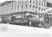 Crested Butte mixed train loading at La Veta Hotel in Gunnison.<br /> D&amp;RG  Gunnison, CO  Taken by Beam, George L. - 1910