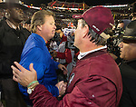 Florida head coach Jim McElwain, left, and Florida State head coach Jimbo Fisher meet at mid-field after Florida State defeated Florida 31-13 in an NCAA college football game in Tallahassee, Fla., Saturday, Nov. 26, 2016. (AP Photo/Mark Wallheiser)