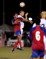 Kyle Davies heads the ball. Costa Rica defeated the US Under 20 Men's National team 3-0 during the 2009 CONCACAF U-20 Championship game at Marvin Lee Stadium Trinidad & Tobago in Macoya, Trinidad on March 17th, 2009.
