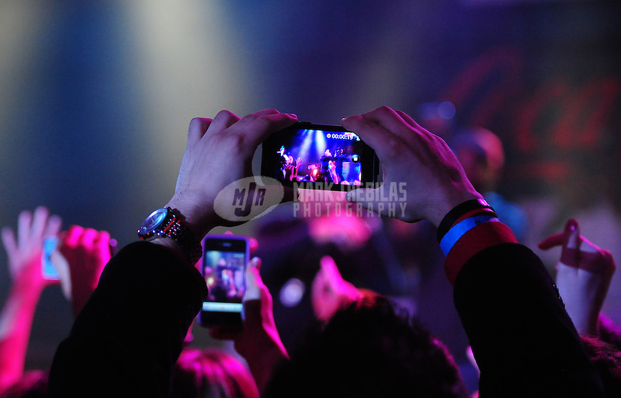 Feb 4, 2012; Indianapolis, IN, USA; Detailed view of fans taking pictures with camera phones as rapper Ludacris performs during The Maxim Party at Indiana State Fairgrounds. Mandatory Credit: Mark J. Rebilas-