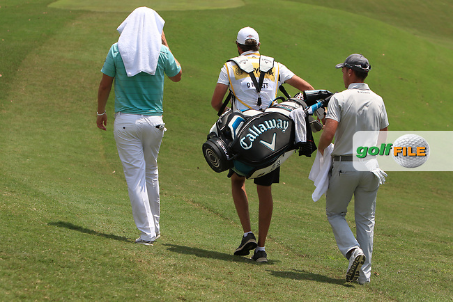 Bernd Wiesberger (AUT) and Danny Willett (ENG) walk down the 3rd fairway during Round 1 of the Maybank Championship at the Saujana Golf and Country Club in Kuala Lumpur on Thursday 1st February 2018.<br /> Picture:  Thos Caffrey / www.golffile.ie<br /> <br /> All photo usage must carry mandatory copyright credit (© Golffile | Thos Caffrey)