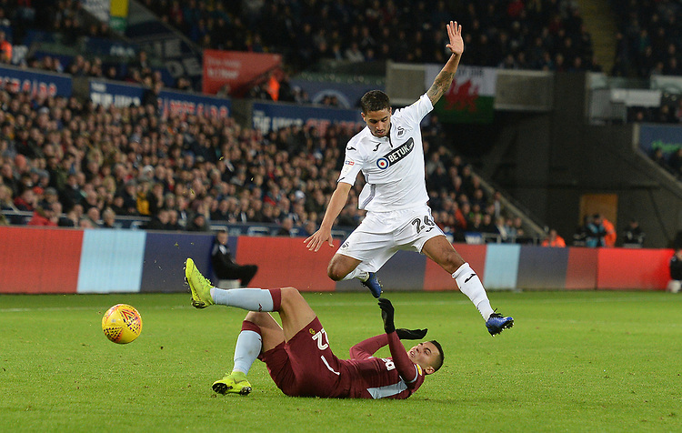 Aston Villa's Anwar El Ghazi is tackled by Swansea City's Kyle Naughton<br /> <br /> Photographer Ian Cook/CameraSport<br /> <br /> The EFL Sky Bet Championship - Swansea City v Aston Villa - Wednesday 26th December 2018 - Liberty Stadium - Swansea<br /> <br /> World Copyright © 2018 CameraSport. All rights reserved. 43 Linden Ave. Countesthorpe. Leicester. England. LE8 5PG - Tel: +44 (0) 116 277 4147 - admin@camerasport.com - www.camerasport.com