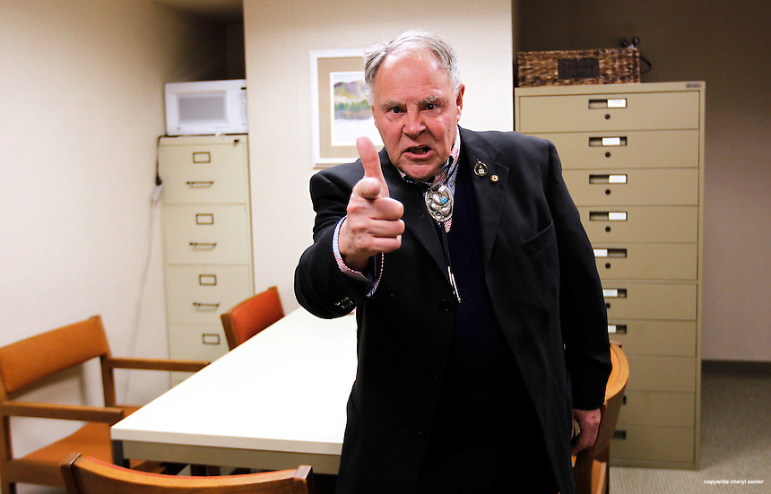 In the Concord, N.H. Legislative Building Tuesday, Jan. 11, 2011, State Representative Henry Parkhurst of Winchester, N.H., (replaying the scene) still remembers clearly the day in 2009 when a group of gun toting Free Staters attended a legislative session concerning the 2nd Ammendment.  Angry about the outcome of the vote, one Free Stater, carrying a rifle, pointed his finger, like a gun, directly at Parkhurst's face.   New Hampshire's legislature last week voted to allow lawmakers to carry firearms anywhere in the statehouse.(Cheryl Senter for the Boston Globe)