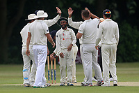 J Lord of Wanstead is congratulated by his team mates after taking the wicket of M Ahktar during Wanstead and Snaresbrook CC vs Ilford CC, Shepherd Neame Essex League Cricket at Overton Drive on 17th June 2017